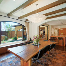 Mediterranean Dining Room by Toro-Lombardo Design Build