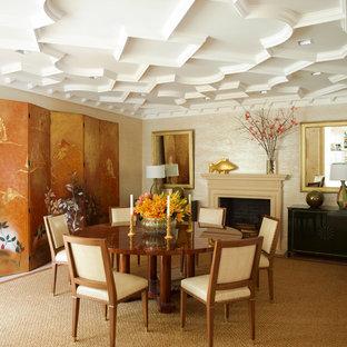 Ispirazione per una sala da pranzo etnica con pareti beige e camino classico