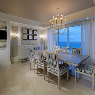 Example of a mid-sized coastal marble floor dining room design in New York with blue walls