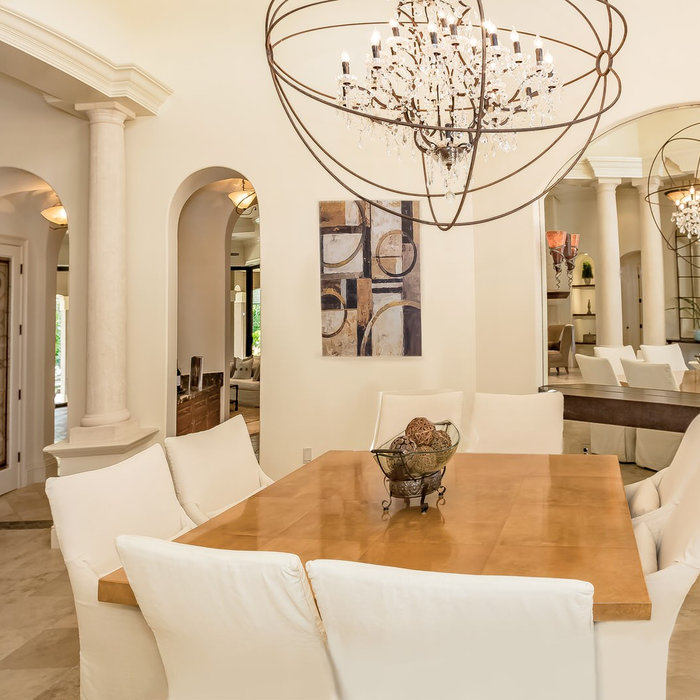 Dining Room in a Palmer's Creek Contemporary in Sarasota, Florida. Design by Doshia Wagner of NonStop Staging. Photography by Christina Cook Lee.