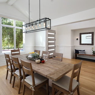 Great room - large cottage medium tone wood floor and brown floor great room idea in San Francisco with white walls and no fireplace