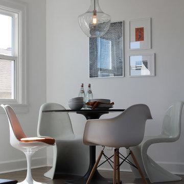 Panton, Saarinen and Eames Chairs with Saarinen Table and Edison Bulb Pendant