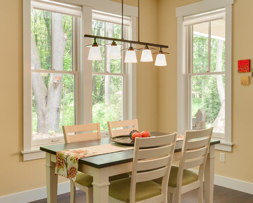 Example Of A Mid Sized Arts And Crafts Dining Room Design In Grand Rapids