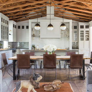 Dining room - mid-sized country medium tone wood floor and brown floor dining room idea in San Francisco with white walls and no fireplace