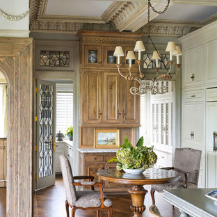 Example of a small ornate medium tone wood floor kitchen/dining room combo design in Minneapolis with no fireplace
