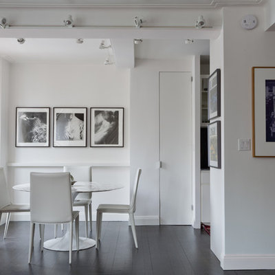 Inspiration for a contemporary dining room remodel in New York with white walls