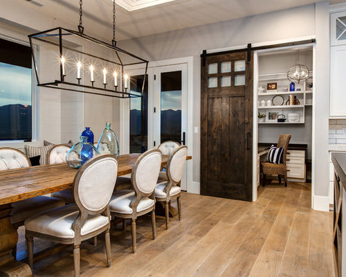 Example Of A Coastal Light Wood Floor Kitchen Dining Room Combo Design In Salt Lake