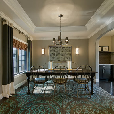 Example of a classic dark wood floor enclosed dining room design in Denver with gray walls