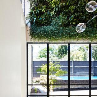 Inspiration for a modern dining room remodel in Melbourne