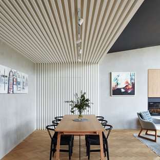 Design ideas for a contemporary open plan dining in Adelaide with grey walls, light hardwood floors and beige floor.