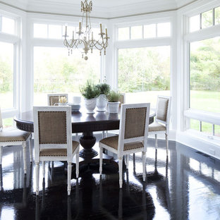 Mid-sized transitional painted wood floor and black floor dining room photo in Minneapolis with white walls