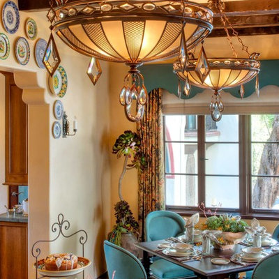 Example of a tuscan dark wood floor dining room design in Los Angeles with beige walls