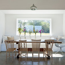 Farmhouse Dining Room by ZeroEnergy Design
