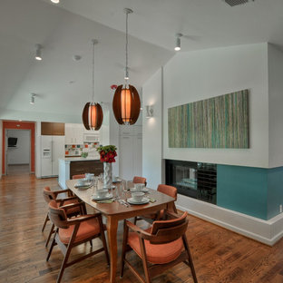 Mid-sized 1960s dark wood floor great room photo in Dallas with white walls, a two-sided fireplace and a tile fireplace