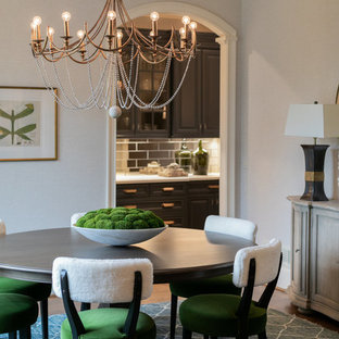 Transitional medium tone wood floor and brown floor enclosed dining room photo in Atlanta with gray walls