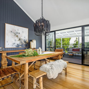 Inspiration for a mid-sized contemporary open plan dining in Sunshine Coast with white walls, medium hardwood floors and brown floor.