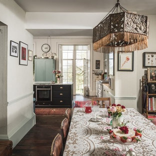 Design ideas for a shabby-chic style dining room in Other with beige walls, dark hardwood floors and brown floor.