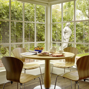 Example of a trendy dark wood floor dining room design in San Francisco with beige walls