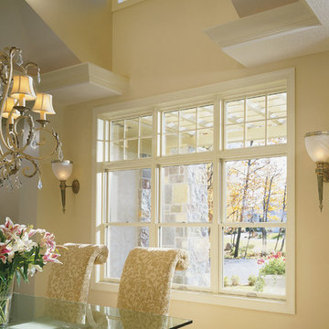 Pella® Architect Series® double-hung and fixed windows lighten up dining areas