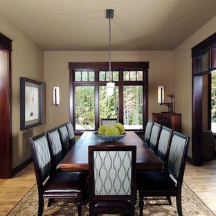 Elegant medium tone wood floor dining room photo in Grand Rapids with beige walls