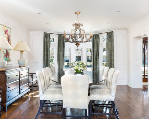 Example Of A Classic Brown Floor And Medium Tone Wood Dining Room Design In Austin