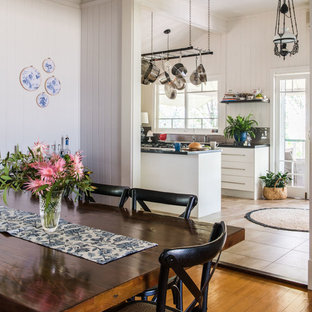 Design ideas for a mid-sized country separate dining room in Brisbane with grey walls.