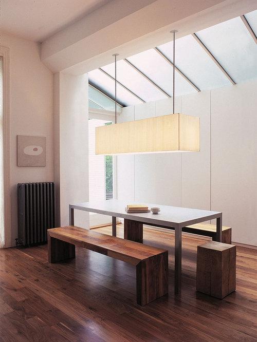 modern dark wood floor dining room idea in philadelphia