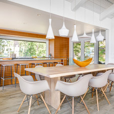 Beach Style Dining Room by Johnson + McLeod Design Consultants