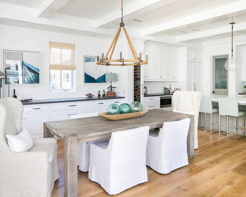Example Of A Coastal Light Wood Floor Kitchen/dining Room Combo Design In  Orange County