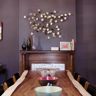 ニューオリンズの中サイズのミッドセンチュリースタイルのおしゃれな独立型ダイニング (紫の壁、濃色無垢フローリング、標準型暖炉、タイルの暖炉まわり) の写真