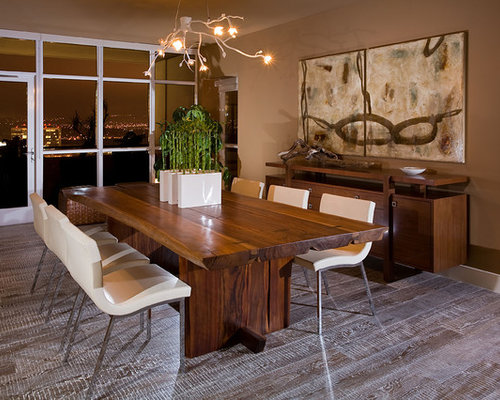 Rustic Dining Room Idea In Orange County With Brown Walls