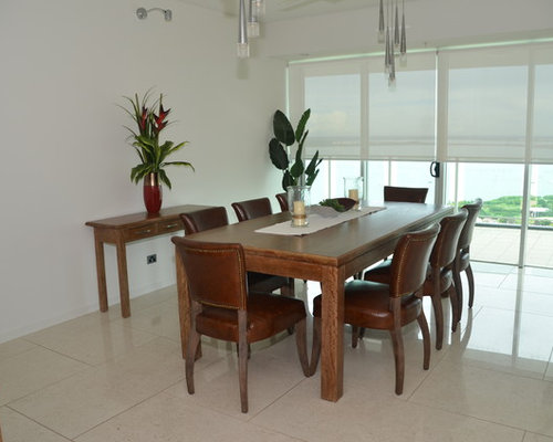 Design ideas for a small modern kitchen dining combo in darwin with white walls and