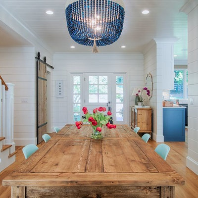 Inspiration for a mid-sized farmhouse light wood floor and beige floor kitchen/dining room combo remodel in San Francisco with white walls and no fireplace