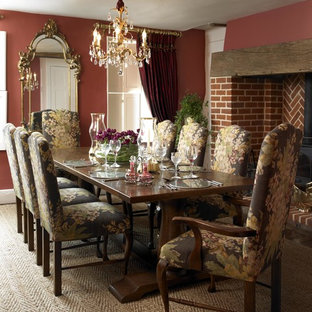Farmhouse Carpeted Enclosed Dining Room Photo In London With Red Walls A Wood Stove And