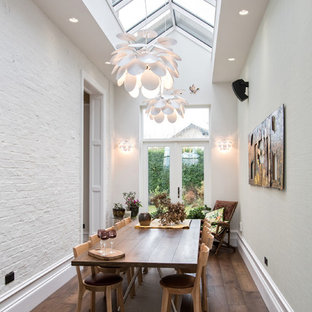 Inspiration for a classic enclosed dining room in Manchester with white walls, dark hardwood flooring and brown floors.