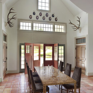 Dining room - rustic terra-cotta floor and pink floor dining room idea in Boston with white walls