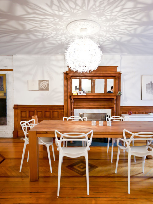 Trendy Medium Tone Wood Floor Dining Room Photo In New York With White Walls