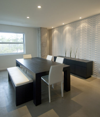 modern dining room by Intexure Architects