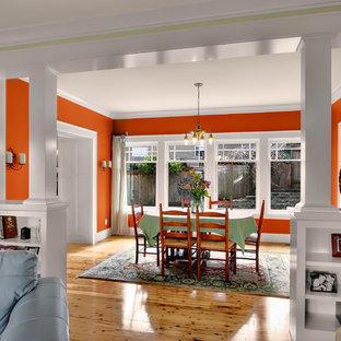 Idee per una sala da pranzo american style con pareti arancioni