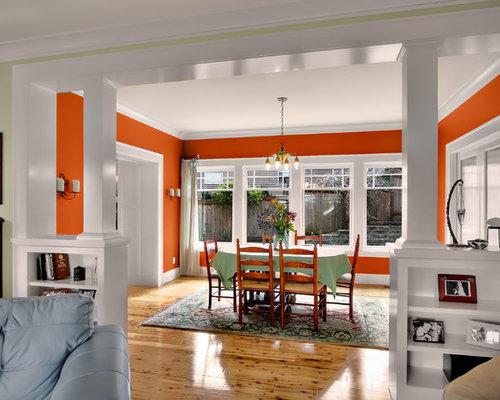 Salle manger craftsman avec un mur orange photos et for Salle a manger orange