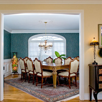 Dining room - traditional medium tone wood floor dining room idea in Other with beige walls