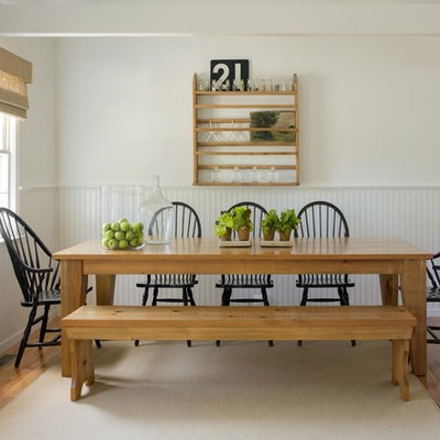 Beach style medium tone wood floor dining room photo in Boston with white walls and no fireplace