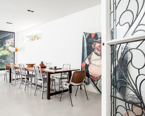 eclectic dining room designs. inspiration for an eclectic dining room in london with white walls and concrete flooring. designs i
