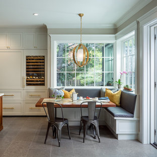 Inspiration for a timeless gray floor kitchen/dining room combo remodel in San Francisco with beige walls