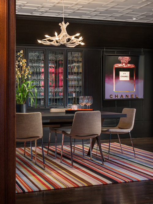 Example Of A Trendy Dining Room Design In San Francisco With Black Walls And Dark Hardwood