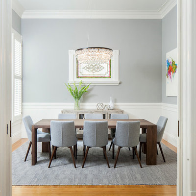 Inspiration for a transitional medium tone wood floor enclosed dining room remodel in San Francisco with gray walls