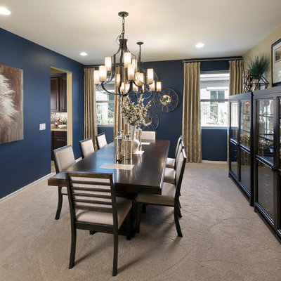 Elegant carpeted enclosed dining room photo in Phoenix with blue walls