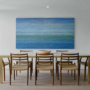Inspiration for a modern light wood floor and beige floor dining room remodel in Santa Barbara with white walls