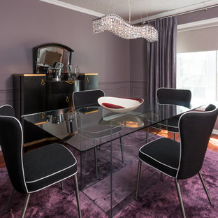 Design ideas for a mid-sized eclectic separate dining room in Toronto with purple walls and medium hardwood floors.