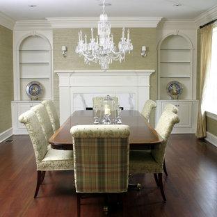Foto di una grande sala da pranzo chic chiusa con pareti grigie, parquet scuro, camino classico, cornice del camino piastrellata e pavimento marrone